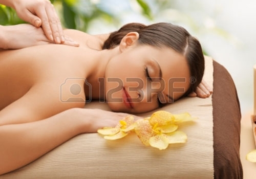 22184539-beauty-holidays-and-spa-concept–woman-in-spa-salon-getting-massage